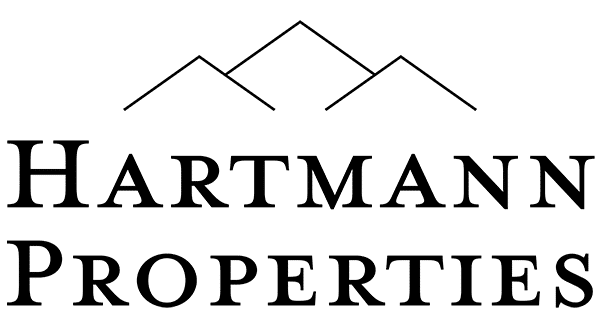 Black logo of Hartmann Properties