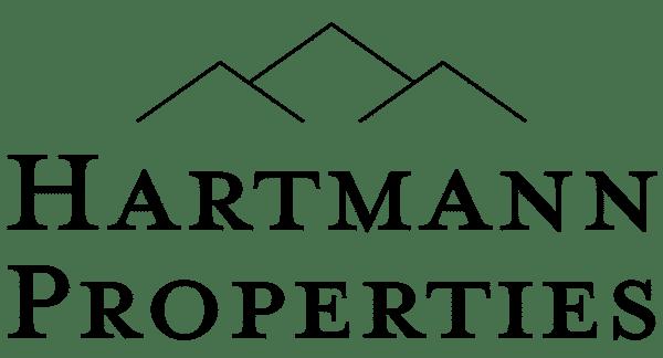 Black logo of Hartmann Properties