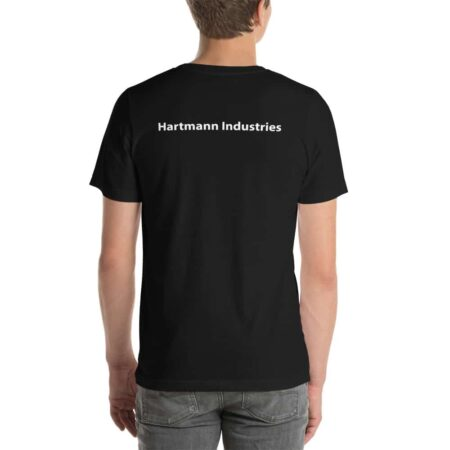 "Photo of a man wearing a black t-shirt, taken from the back. The shirt says ""Hartmann Industries"" in white text"